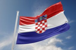 Croatia flag is waving at a beautiful and peaceful sky in day time while sun is shining. 3D Rendering